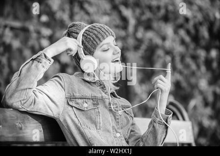 Feeling awesome  Cool funky girl enjoy music in headphones