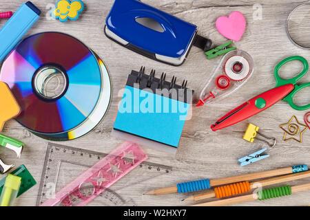 School supplies on wooden background.
