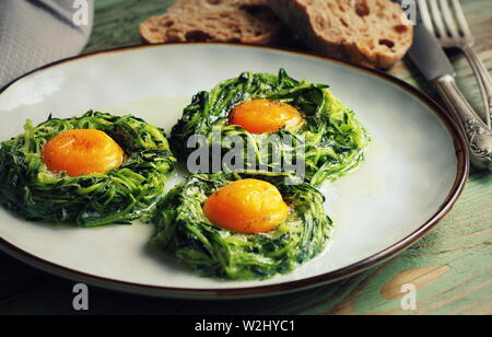 Fried egg in zucchini noodle nest, healthy breakfast, top view - Stock Photo