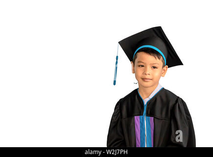 The boy graduated from kindergarten This study is the first to advance to the next level on a white background with clipping path. - Stock Photo