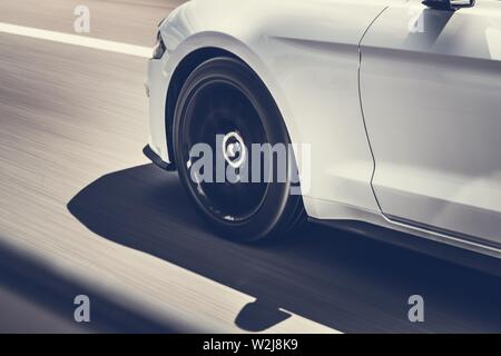 Car Speeding on a Highway. Automotive Concept Photo with Motion Blur. Modern Vehicle Driving. - Stock Photo
