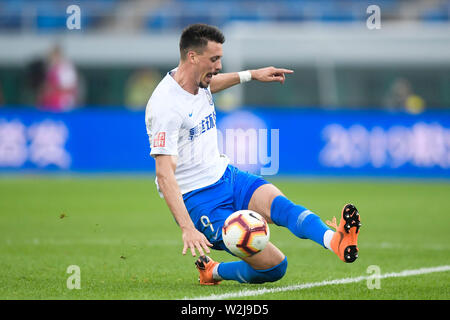 German football player Sandro Wagner of Tianjin TEDA dribbles against Jiangsu Suning in their 15th round match during the 2019 Chinese Football Association Super League (CSL) in Tianjin, China, 7 July 2019. Tianjin TEDA defeated Jiangsu Suning 2-1. - Stock Photo