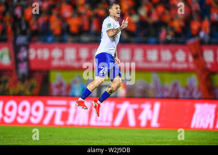 Brazilian football player Roger Krug Guedes, known as Roger Guedes, of Shandong Luneng Taishan celebrates after scoring against Beijing Renhe in their 16th round match during the 2019 Chinese Football Association Super League (CSL) in Beijing, China, 7 July 2019. Shandong Luneng Taishan defeated Beijing Renhe 2-0. - Stock Photo