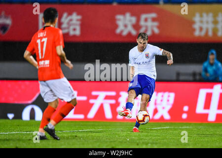 Brazilian football player Roger Krug Guedes, known as Roger Guedes, of Shandong Luneng Taishan shots the ball against Beijing Renhe in their 16th round match during the 2019 Chinese Football Association Super League (CSL) in Beijing, China, 7 July 2019. Shandong Luneng Taishan defeated Beijing Renhe 2-0. - Stock Photo
