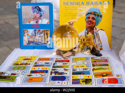 Plaza de la Catedral, Havana, Cuba - January 2, 2019: The Afro-Cuban priestess or Santera La Señora Habana's shows of her tarot cards. - Stock Photo
