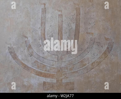 Interior of the Izaak Synagogue in Kazimierz showing candelabra on wall. The synagogue is in the historic Jewish quarter of Krakow, Poland. - Stock Photo