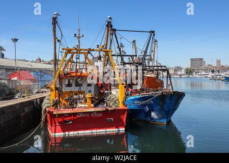 Plymouth Sutton Harbour, inner basin, colourful fishing boats at rest in a safe haven. - Stock Photo