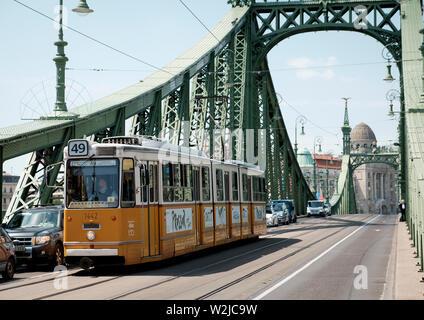 A tram on Szabadsag Bridge (Liberty Bridge), crossing the River Danube, Budapest - Stock Photo