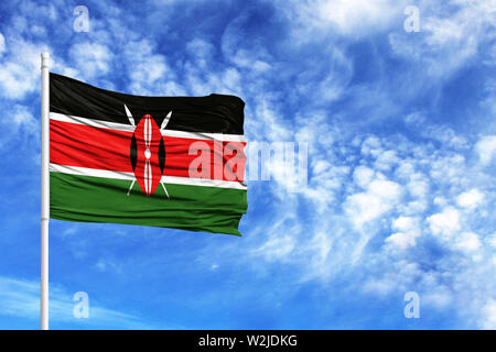 National flag of Kenya on a flagpole in front of blue sky - Stock Photo