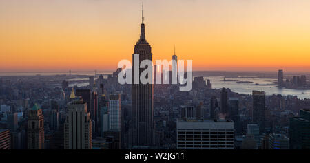 New York City, NY, USA - November 4, 2015:  Midtown Manhattan at Sunset and Skycsrapers (Empire State Building and World Trade Center) - Stock Photo