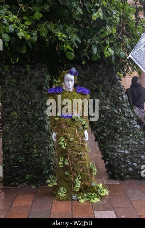 Glasgow, Scotland, UK. 9th July, 2019. UK Weather. A floral mannequin advertising the formal opening of the restaurant The Ivy in Buchanan Street will be on 29th July 2019. Credit: Skully/Alamy Live News - Stock Photo
