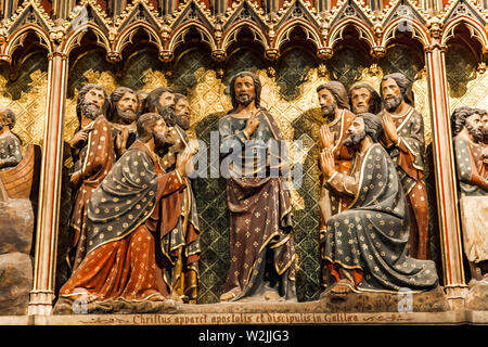 Carved wall with Appearance to the apostles and disciples at Galilee in Cathedrale Notre Dame de Paris, France. - Stock Photo