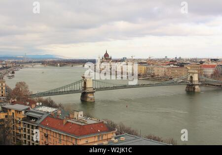 A  view looking up the river Danube in Budapest, from the Buda side, of the 'Chain Bridge', the 'Margaret Bridge', and the Pest side of the city. - Stock Photo