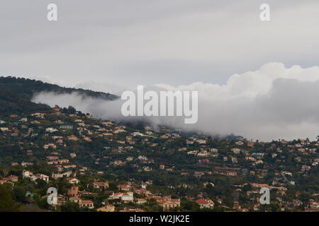 View on Mandelieu-La Napoule from the mountain in France. Steam formation in the mountains. - Stock Photo