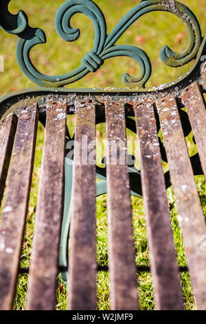 Detail of an old cast iron and wood park bench - Stock Photo