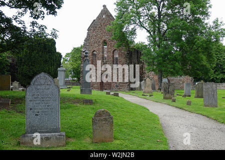 The Beauty Priory cemetery and church ruins - originally built in the 1200s AD in Inverness-shire, Scotland - are shown during an afternoon day. - Stock Photo