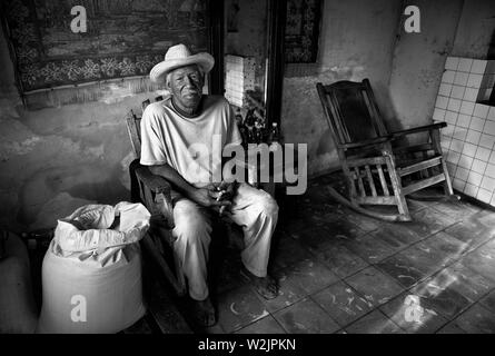 Old man at home in Trinidad - Stock Photo