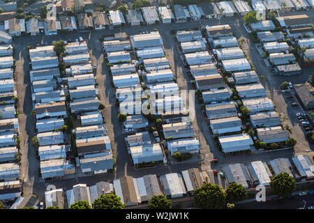 Aerial view of generic older mobile home rooftops in the southwest United States. - Stock Photo