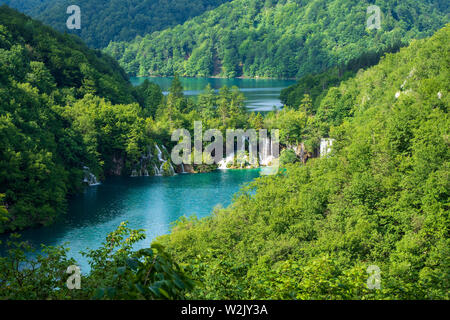 Rushing water from the Goat Lake cascades down the natural barriers into the Milan's Lake at the Plitvice Lakes National Park in Croatia - Stock Photo