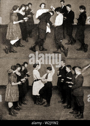 'Pop Goes The Weasle'  dance being performed  by British school children at school c1930s - Stock Photo