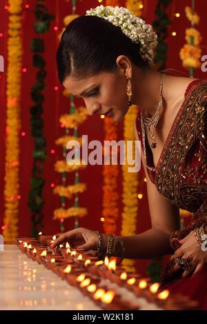 Woman celebrating Diwali - Stock Photo