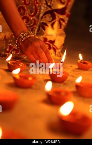 Indian woman celebrating Diwali - Stock Photo