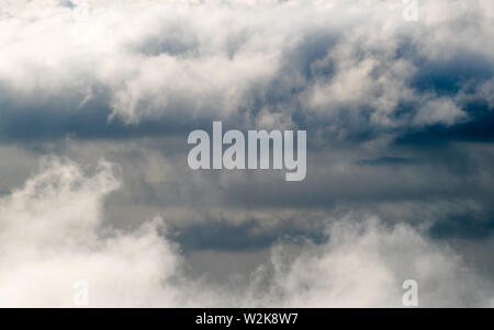 Dark stormy rain clouds in the sky. Dramatic rain cloud background without land, bad weather - Stock Photo