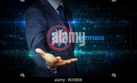A businessman in suit touch the screen with antivirus symbol hologram. Man using virtual interface. Firewall, computer protection, online safety and c - Stock Photo