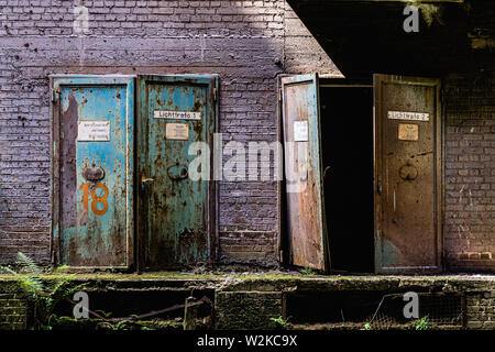 Old steel doors at a steel work site - Stock Photo