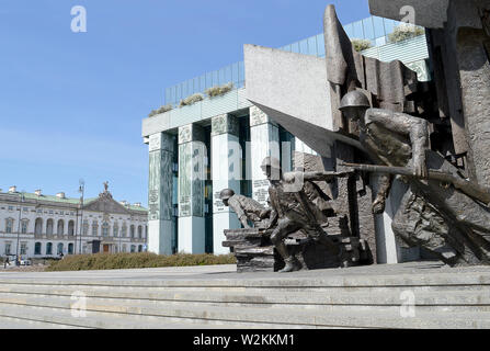 One of the statues at the 1944 Warsaw Uprising monument showing Polish fighters coming out of a falling building stands in front of the  Supreme Court. - Stock Photo