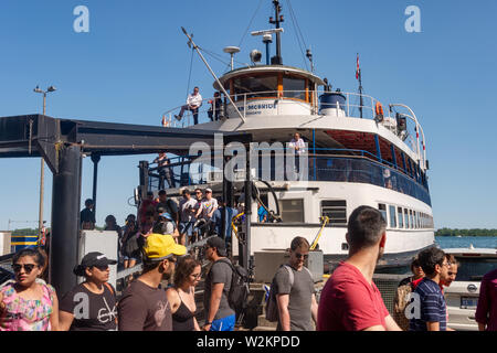 Toronto, CA - 23 June 2019: People boarding the ferry on Toronto center Island - Stock Photo