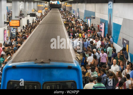 Rio de Janeiro, Brazil - November 07, 2016: a crowd of people at the Botafogo metro station at rush hour to get back home after a working day - Stock Photo