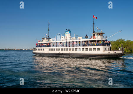 Toronto, CA - 23 June 2019: Ferry on its way to Toronto harbour. - Stock Photo