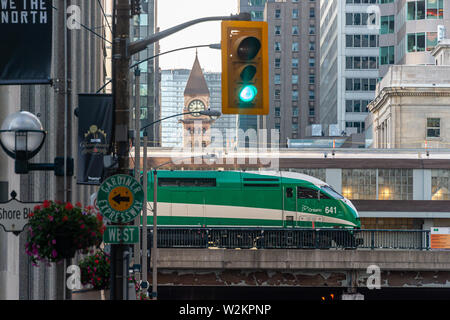 Toronto, CA - 22 June 2019: Picture of a GO Transit green train as seen from Bay street. - Stock Photo