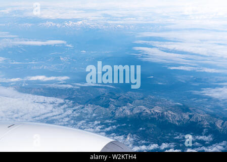 Endless cloudy sky, view from the airplane. Airline theme, travel and business trip by plane - Stock Photo