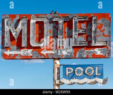 A dilapidated, vintage motel sign in the desert of Arizona - Stock Photo