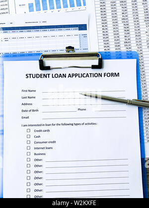 Student loan application form document on table - Stock Photo