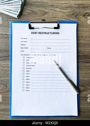 Debt restructuring document with graph on table. - Stock Photo