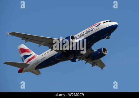 A British Airways Airbus A319-100 takes off from Manchester International Airport (Editorial use only) - Stock Photo