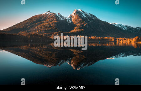Fantastic sunrise at Hintersee lake. Beautiful scene of trees on a rock island during Spring in Berchtesgaden Germany - Stock Photo