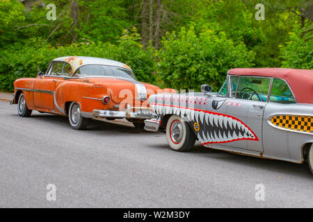 Turku, Finland - 02 July, 2018: Circa 1954 Pontiac Chieftan and circa 1958 Edsel Pacer convertible painted like a WWII era fighter plane. - Stock Photo