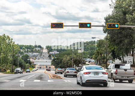 Tallahassee, USA - April 26, 2018: Capital city street road highway with cars in traffic jam in Florida day with light signal - Stock Photo