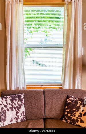 Rustic living room sofa with window blinds curtains and closeup of couch wooden frame in cottage house old interior design - Stock Photo