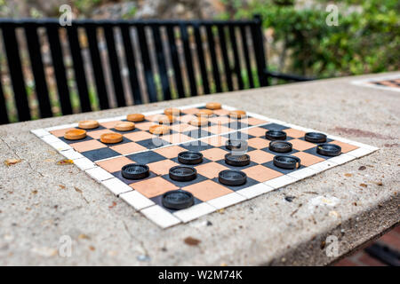 Checkers table in park in Hot Springs, Arkansas with nobody during summer day with benches - Stock Photo