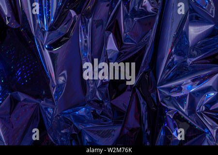 The background of crumpled holographic packaging film with an abstract pattern. - Stock Photo