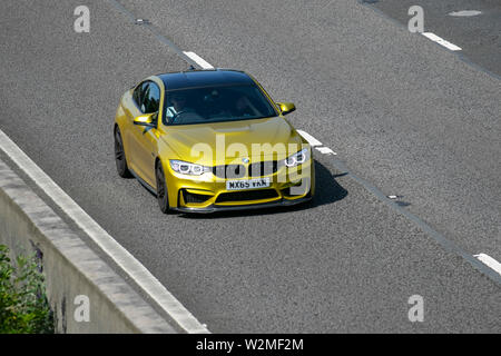 2015  yellow green BMW M4 S-A; Motoring classics, historics, vintage motors and collectibles 2019; Leighton Hall transport show, cars & veteran vehicles of yesteryear on the M6 motorway near Lancaster, UK - Stock Photo