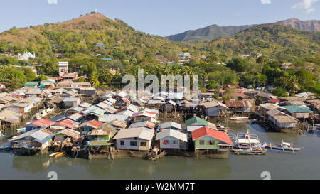 Aerial view Coron city with slums and poor district. Palawan.Wooden houses near the water.Poor neighborhoods and slums in the city of Coron aerial view