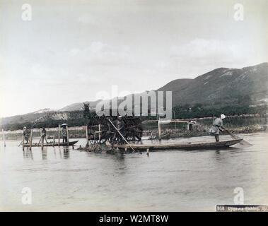 [ 1890s Japan - Japanese Fishermen ] —   Fishermen in flat boats hauling in fishing nets on Ujigawa River, Uji, Kyoto Prefecture.  19th century vintage albumen photograph. - Stock Photo