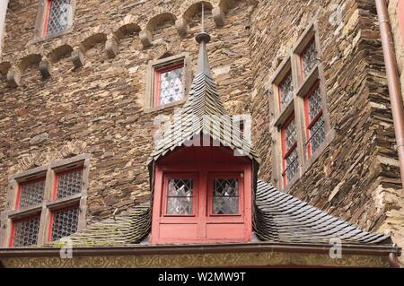 Detail of a red window under a black roof tiles in a medieval town (Germany, Europe) - Stock Photo