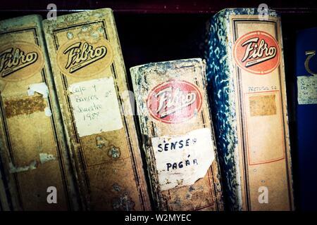 Close up of invoice folders on a shelf. Mahon, Balearic Islands, Spain, Europe. - Stock Photo